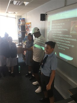 Photo:Paul Canoville told Y6 children at Servite school about his mother Udine's ambition to become a nurse in the new NHS.  She was part of the Windrush generation that the class celebrated through the calypso song 'London is the Place for Me' (by Lord Kitchener).