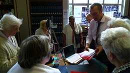 Photo:Education Officer, Peter Daniel and WCRAG group share memories of the Blitz at Westminster Reference Library